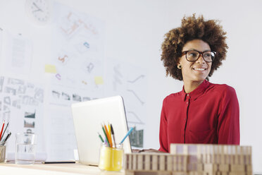 Portrait of smiling young female architect at her office - EBSF000347