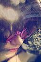Relaxing young woman wearing sunglasses, Double Exposure - HOHF001114