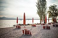 Italy, Peschiera del Garda, Lake Garda, coast at early morning - SBDF001435