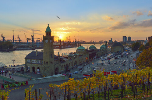Germany, Hamburg, Port of Hamburg and Landungsbruecken at sunset - RJF000357