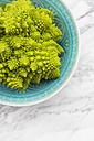Bowl with Romanesco, Brassica oleracea convar. botrytis var. botrytis, on white marble - LVF002210