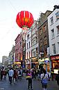 UK, London, Soho, Chinatown, Wardour Street, people shopping underneath red lampion - MIZ000677