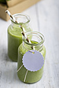 Spinach smoothie in glass with blank tag - ODF000868