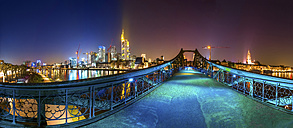 Germany, Hesse, Frankfurt, view to Eiserner Steg with skyline in the background at night - PUF000316