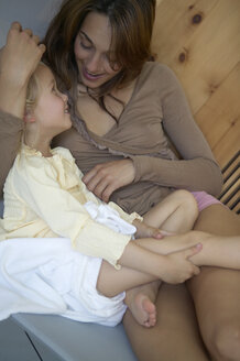 Mother and daughter relaxing in hotel spa - FSF000334