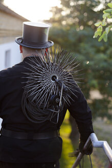 Germany, chimney sweep with working tools, back view - HCF000087