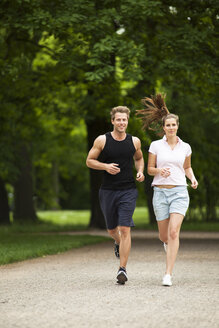 Man and woman jogging in park - CvKF000213