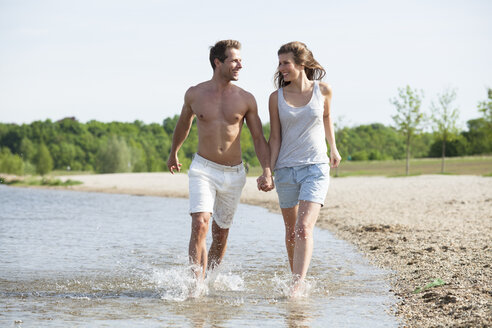 Happy couple wading in water - CvKF000178