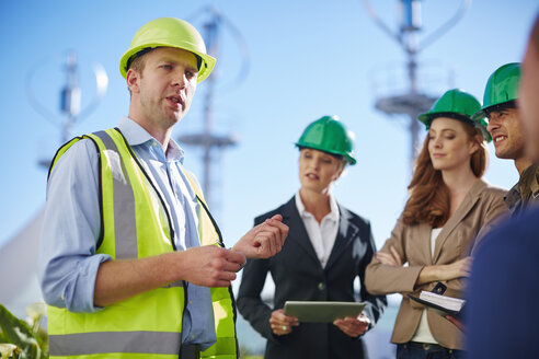 Business partners having a meeting with wind turbine engineer - ZEF002246