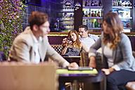 Couple socializing at hotel bar - ZEF002485
