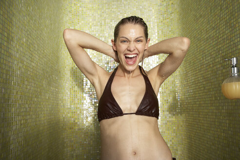 Portrait of happy woman taking a shower - FSF000398
