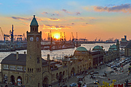 Germany, Hamburg, Port of Hamburg and Landungsbruecken at sunset - RJ000358