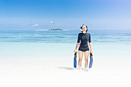 Maldives, Ari Atoll, young female diver coming out of water - FLF000583
