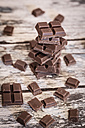 Stack of chocolate pieces on wood - SARF001045