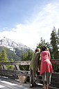 Switzerland, two young women standing on terrace looking at view - FSF000359