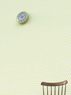 Back rest and wall clock in front of wallpaper with polka dots - UWF000259