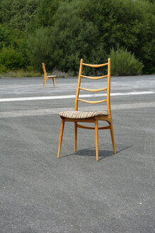Two wood chairs on a runway - AXF000733
