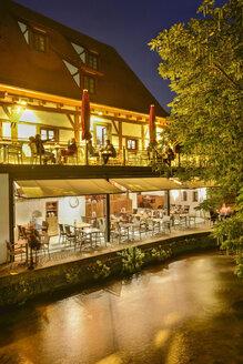 Germany, Baden-Wuerttemberg, Ulm, restaurant at River Blau at night - SH001585