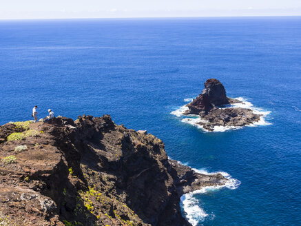 Spain, Canary Islands, La Palma, tourists at the cliff coast of Garafia - AMF003257