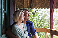 Happy mature couple in garden - RBF001945
