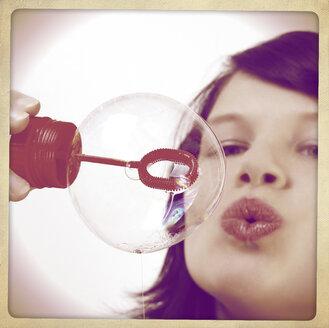 Woman blowing soap bubble - HOHF001175