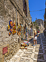 Italy, Sicily, Erice, view to alley with gift shop - AM003278