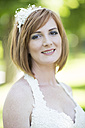 Portrait of smiling bride - ZEF002547
