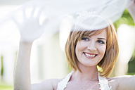 Portrait of smiling bride with veil - ZEF002550