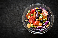 Glass bowl with mixed salad on slate - SARF001059