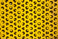 Part of yellow perforated board - WIF001173