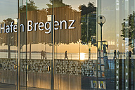 Austria, Vorarlberg, Lake Constance, Bregenz, reflection of sunset in new harbor building - SH001659