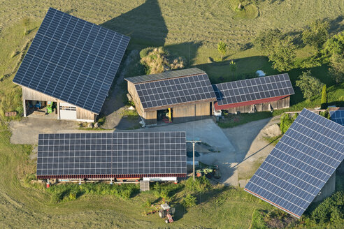 Austria, Vorarlberg, Bregenz, aerial view of solar roof collectors on farm - SH001646