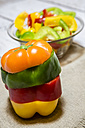 Stack of different bell peppers - SARF001079