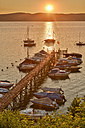 Germany, Baden-Wuerttemberg, Lake Constance, Constance, jetty with boats at sunrise - SH001721