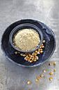 Bowl of cornmeal and maize grains on metal - EVGF001014
