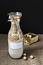Glass bottle with ingredients of baking mix for buckwheat bread - EVGF001028