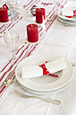 Red-white laid table at Christmas time - LVF002355