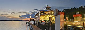 Germany, Baden-Wuerttemberg, Lake Constance, Meersburg, ferry at pier at dusk - SH001764