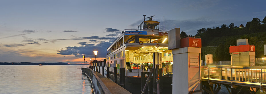 Germany, Baden-Wuerttemberg, Lake Constance, Meersburg, ferry at pier at dusk - SH001764