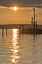 Germany, Baden-Wuerttemberg, Lake Constance, Meersburg, harbor entrance with sculpture magical pillar at sunset - SHF001766