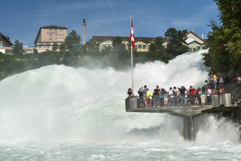 Switzerland, Schaffhausen, tourists on observation deck at Rhine Falls - SH001774
