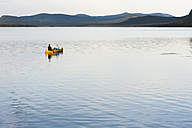 Sweden, Lapland, Norrbotten County, Kvikkjokk, canoeing father, daughter and son on lake Saggat - JBF000197