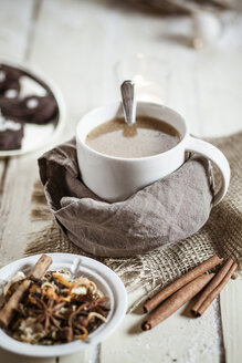 Bowl of Masala chai with almond milk on jute and wood - SBDF001478