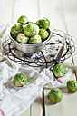 Peeled brussel sprouts in tin bucket, knife, studio - SBDF001446