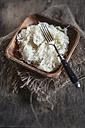 Sauerkraut in wooden bowl with fork, studio - SBDF001451