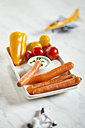 Baby-sized vegetables, carrots, tomatoes, bell pepper with sour-cream-dip, toy horse and plane, studio - SBDF001463