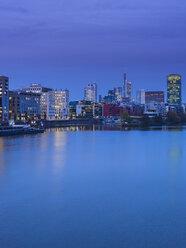Germany, Hesse, Frankfurt, Gutleutviertel, Westhafen, Pier 1 in the evening, Westhafen Tower in the background - AMF003346