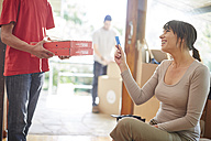 Couple moving house, collecting a pizza order - ZEF002844