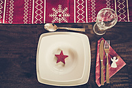 Place setting with Christmas decoration laid dining table - SARF001097