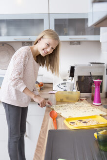 Girl preparing Christmas cookies in a kitchen - VTF000363